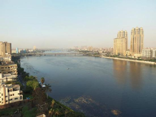 View of the nile at night from our balcony picture of for Terrace hilton zamalek
