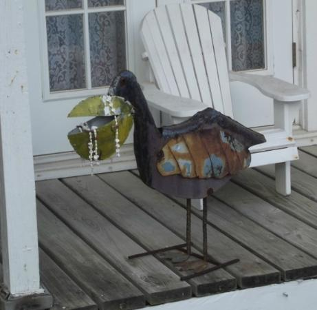 "Coastal Dreams Bed & Breakfast: Some of the ""quirky"" art. A bejeweled metal pelican"