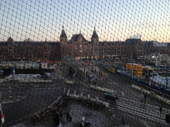 Park Plaza Victoria Amsterdam: View of central station from balcony doors in room 203