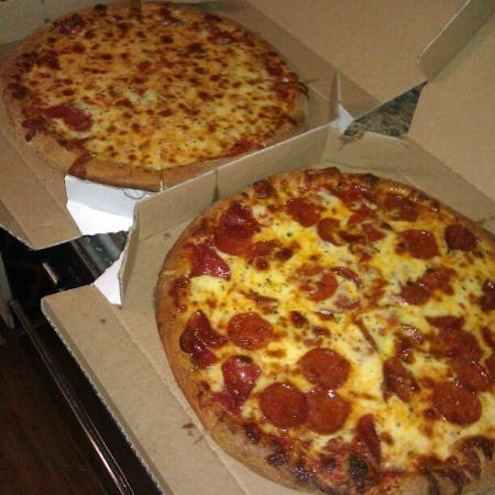 Star Pizza: Hand tossed pepperoni and cheese pizzas ready to be ...
