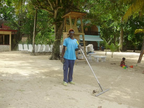 Nirvana on the Beach: Moses, always making sure the surroundings are clean and tidy! Keep up the great job!