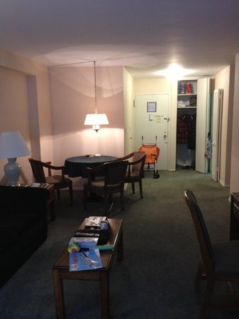 Murray Hill East Suites: Living room, entry door, one of the wardrobes