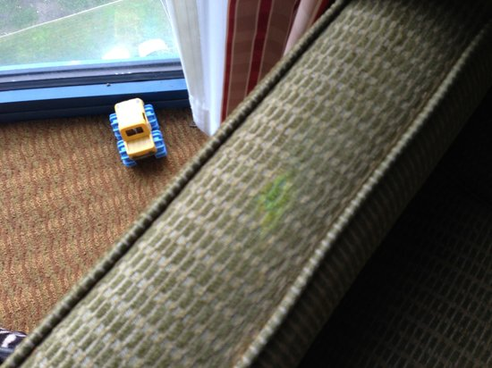 Embassy Suites San Francisco Airport: Bright yellow stain on bedroom chair.  Hard to miss when you look around the room.