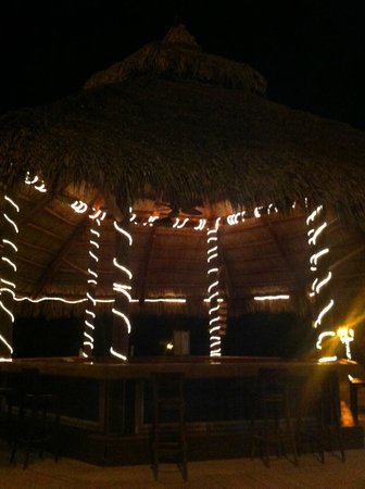 Coconut Cove Resort and Marina: The main tiki hut/bar at night.