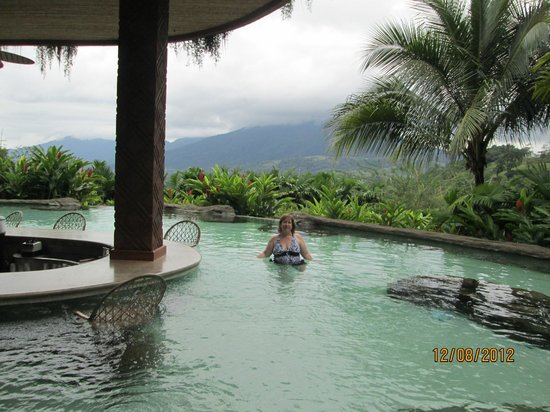 The Springs Resort and Spa: The pool bar with a volcano view