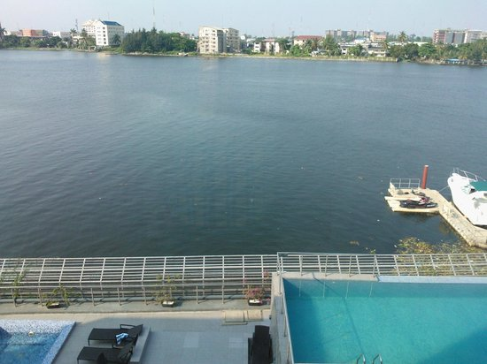 Radisson Blu Anchorage Hotel, Lagos: View from the room overlooking the river, you can also see the pool / bar area