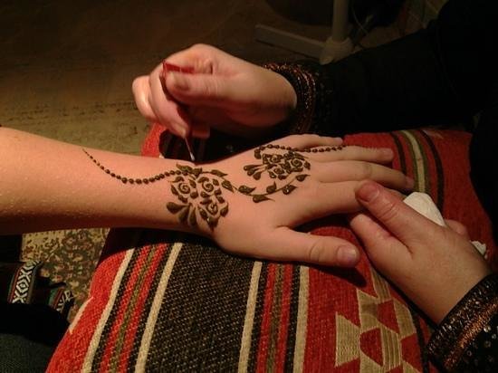 Henna tattoo at the desert safari dinner picture of for Henna tattoos locations