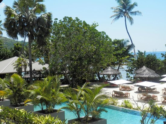 Kempinski Seychelles Resort: Pool Side &amp; Beach - also has a bar in this area for serving at the beach/pool side