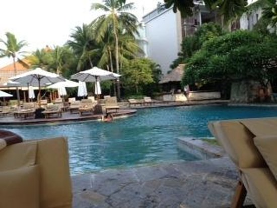 The Royal Beach Seminyak Bali - MGallery Collection: Poolside deck chair looking behind