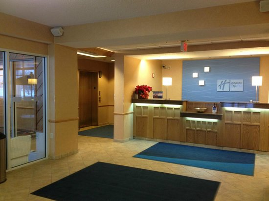 Holiday Inn Express Hudson-I-94: Front desk, with pool area to the left.