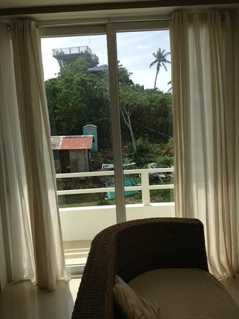 Tanawin Resort and Luxury Apartments: View to outside from room 9