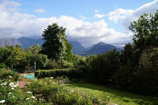 The Garden House: View from breakfast terrasse over garden and valley