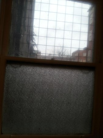County London: Dirty bathroom window