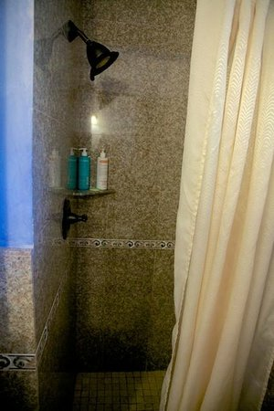 Clarion Collection Carmel By The Sea: Granite shower stall.