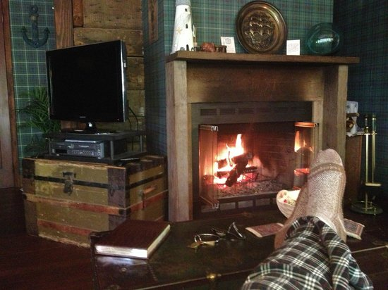Sandlake Country Inn: I spent most of my time in front of the fire. Extra wood was right outside the door!