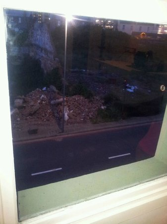 : View from the room- Rubble from a semi demilshed building