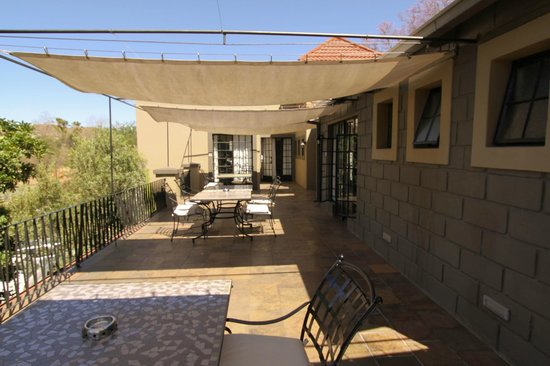 Olive Grove: Upstairs deck eading to several of the Rooms - ours at the end