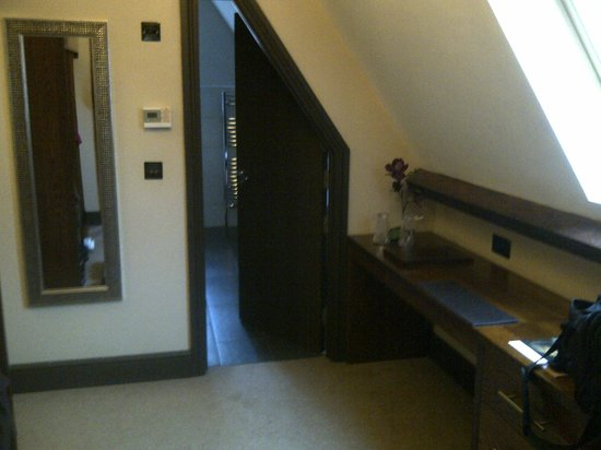 The Duke of Edinburgh Hotel: Elegant accommodation: The door to the bathroom conformed to the roof line.