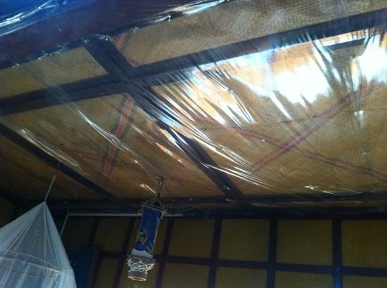 Niu &#39;Ohana Boracay Garden Resort: leak stained ceiling with plastic sheeting to keep the water out