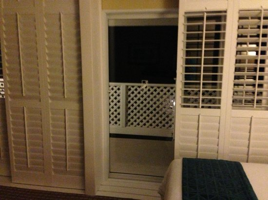 Inn at Morro Bay: Rolling Plantation Shutters and double sliding doors to patio