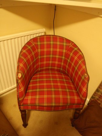 Allt-nan-Ros: Worn out chair in our bedroom. Look at the corners of the arm rest