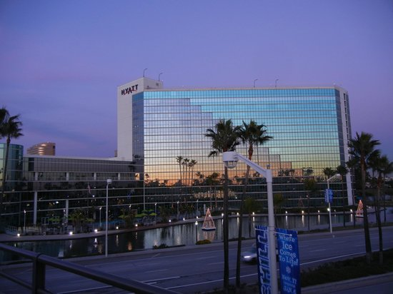 Hyatt Regency Long Beach: View of hotel from marina bridge at sunset