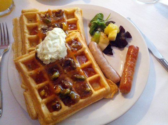 Colby Hill Inn: Waffles with pistachio marmalade, fruit garnish, and breakfast sausage.