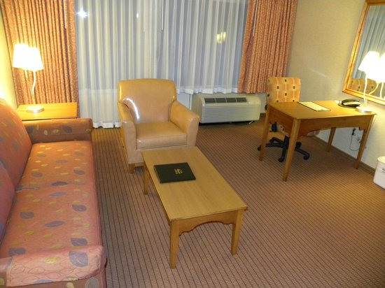Olympic Lodge: Couch, chairs, table in large room