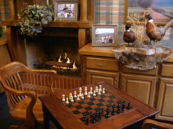 Platte City, MO: Relax By the Fireplace in Our Trophy Room