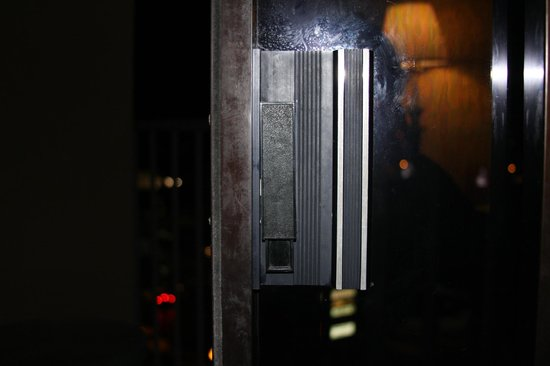 The Edgewater Hotel: No lock except for the bar on the balcony door