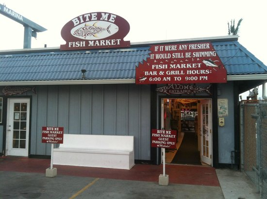 Notice ice hockey on the tv lol picture of bite me fish for Kona fish market