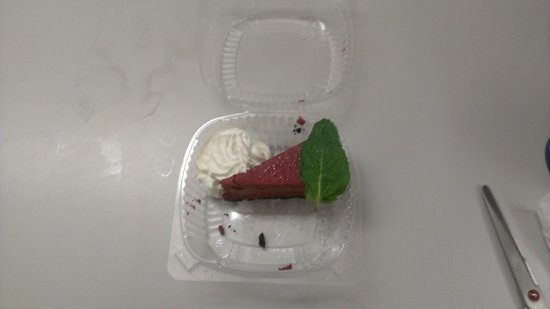 Brandon, FL: $5.99 plus tax/tip for a wafer thin slice of cheesecake? Mint leaf gives some perspective to siz