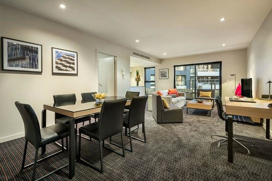 Quest Docklands: Two Bedroom Executive Apartment, Open plan living area with balcony