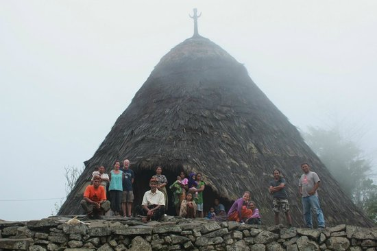 Ruteng, Indonesia: Together with Wae Rebo people in front of mBaru Niang (traditional house)