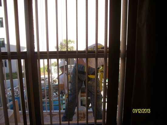 Fountain Beach Resort:                   worker painting on balcony