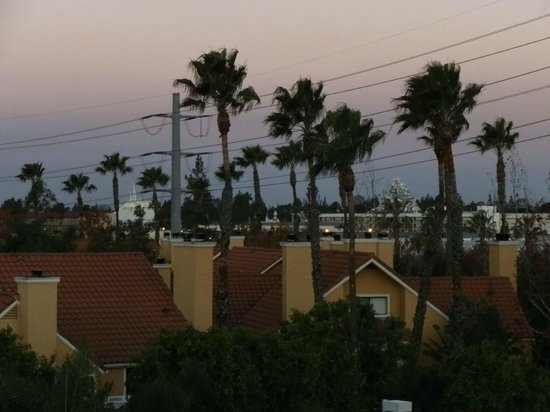 Motel 6 Anaheim Maingate:                   Zoomed view to the right of balcony walkway room 473 view - Disneyland