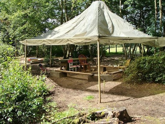 Eco Camp UK - Wild Boar Wood Campsite: The Central Campfire with parachute awning