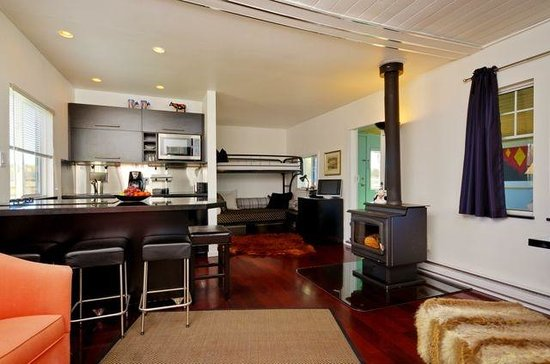 Norton North Ranch Cottages: The Corral Cottage's chic interior with a wood stove for extra cozyness