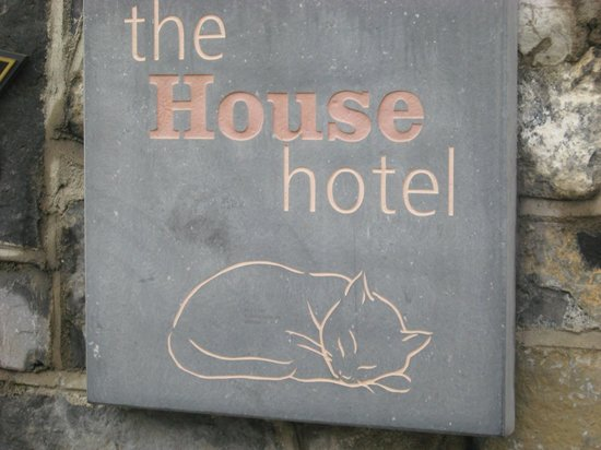 The House Hotel: sign outside.