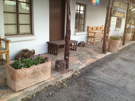 Antelope Lodge:                   Natural planters, benches on porch of office entry