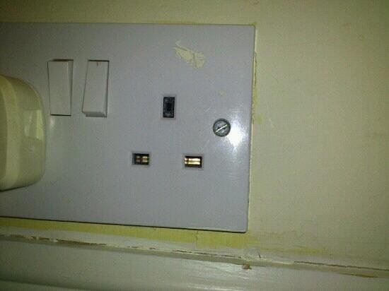 Hollin Hall Hotel:                   Plug socket with broken plug inside.