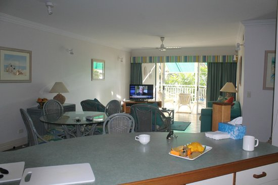 On the Beach Holiday Apartments:                   Living room and balcony - view from kitchen.