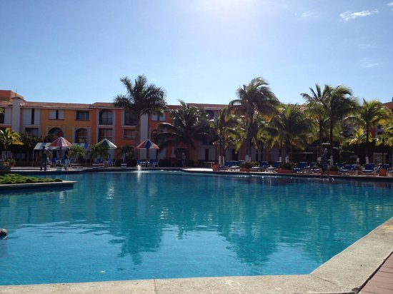 Hotel Cozumel and Resort:                   The pool is in the center of the hotel complex with guest rooms and main lobby