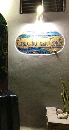 Coqui del Mar Guest House:                   Front entrance sign at night