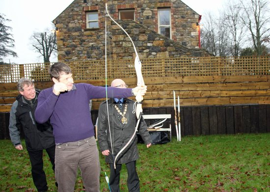 Fermanagh Self Catering - Stables &amp; Rafters: Having a go at archery: guests at official opening