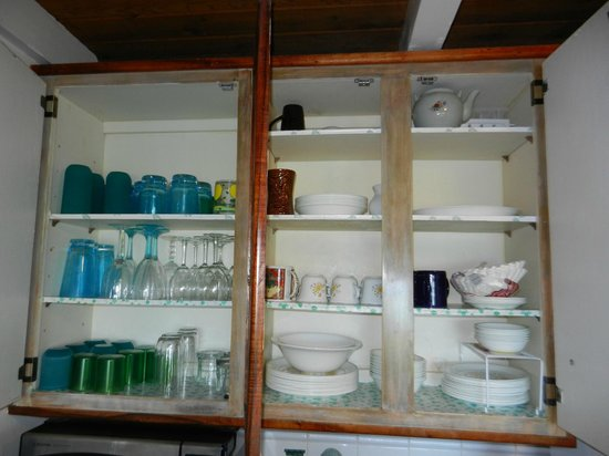 Polynesian Shores:                   Unit #203 Kitchen stocked with wine glasses, mugs, plates etc