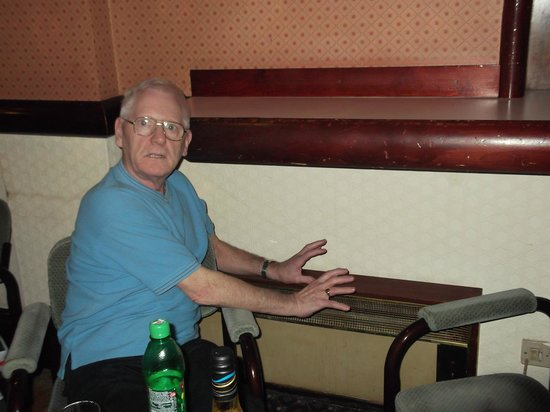 Bay County Hotel: Bill trying to get warm on a cold heater!