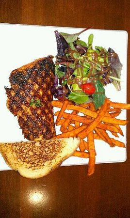 Monrovia, CA:                   Cajun Salmon w/mixed greens & sweet potato fries.....on a paper plate.