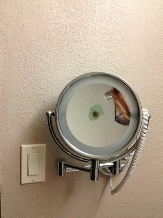The Hotel Acadiana:                   Makeup mirror in one room - looked like a bullet hole.