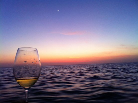 The Residence Zanzibar: Glass of Wine, Sunset on the boat